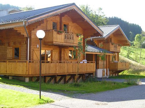 Location au ski Les Chalets Du Bois De Champelle - Morillon - Extérieur été
