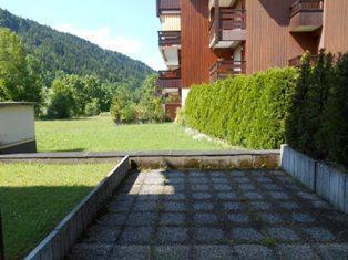 Location au ski Studio cabine 6 personnes (186) - Residence Alpina - Le Grand Bornand - Extérieur été