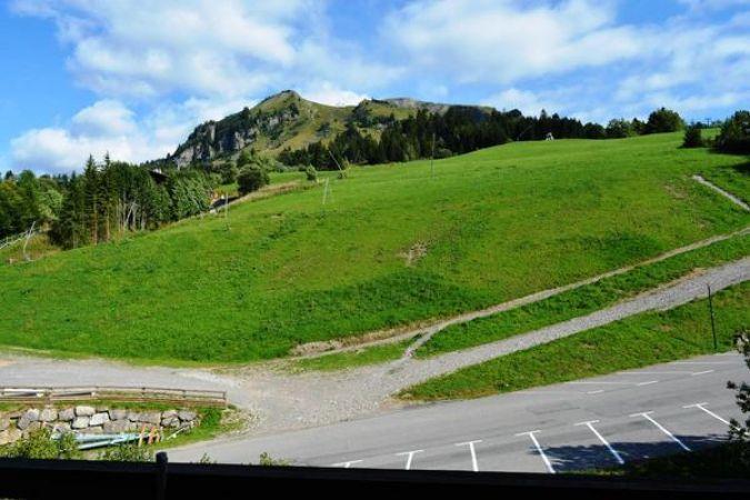 Location au ski Appartement 2 pièces mezzanine 8 personnes (233) - Residence Le Castel Des Neiges - Le Grand Bornand - Extérieur été