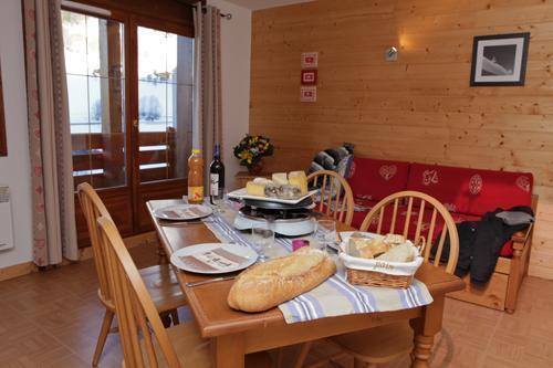 Vacances en montagne Residence Les Chalets Des Evettes - Flumet - Coin repas