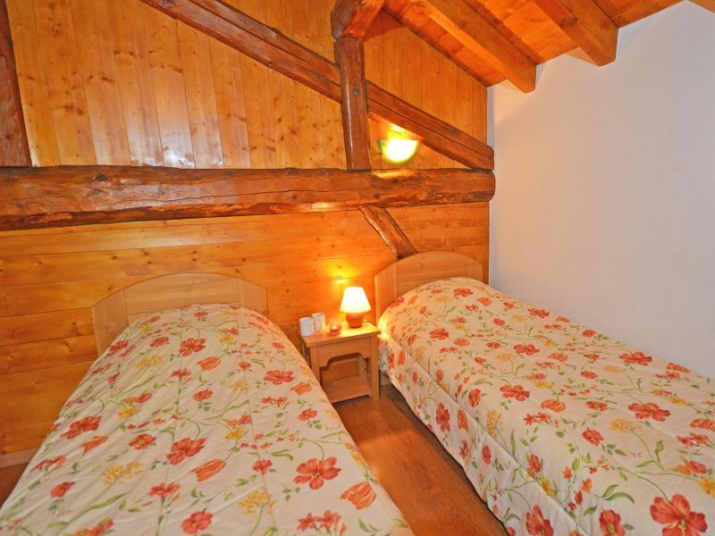 Vacances en montagne Chalet Balcon Cime de Caron - Les Menuires - Chambre mansardée