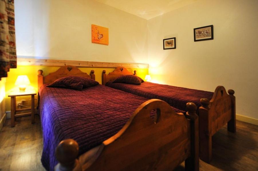 Vacances en montagne Appartement 5 pièces 8 personnes - Chalet le Génépi - Les Menuires - Lit simple