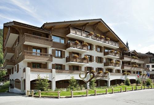 Rent in ski resort Hôtel Au Coeur du Village - La Clusaz - Summer outside