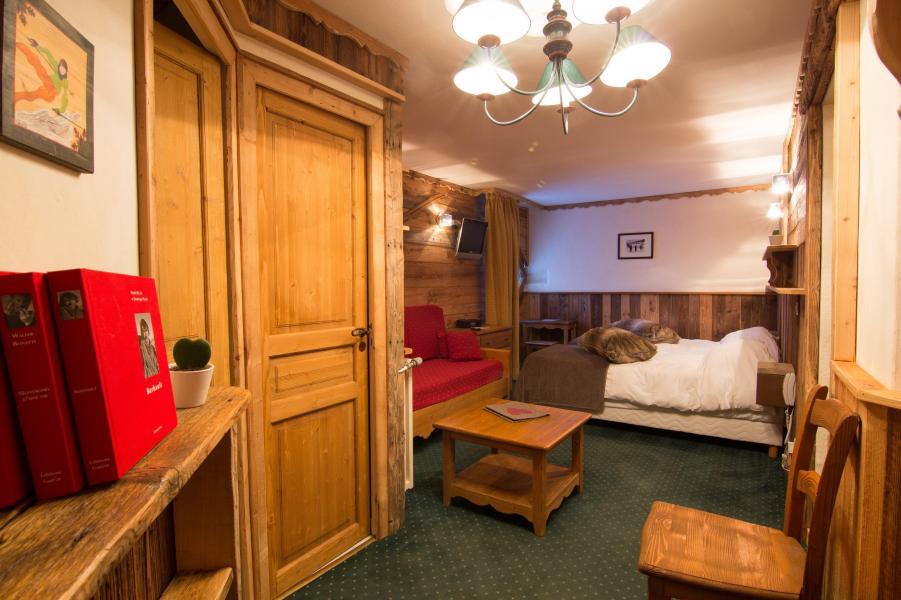 Urlaub in den Bergen Familienschlafzimmer (4 personen) - Hôtel des 3 Vallées - Val Thorens - Wohnzimmer