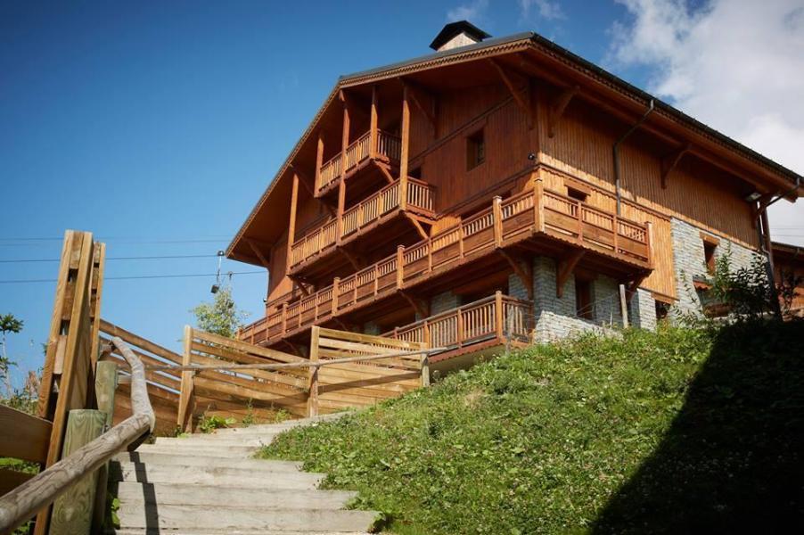 Location au ski Les Chalets Du Soleil Contemporains - Les Menuires - Extérieur été