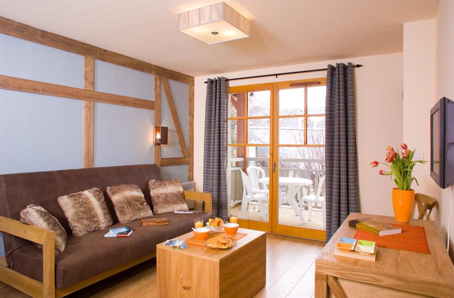 Holiday in mountain resort Résidence Cami Real - Saint Lary Soulan - Settee
