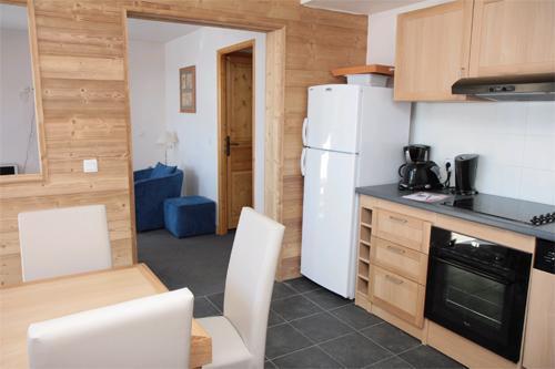 Vacances en montagne Appartement 5 pièces 10 personnes (Famille) - Residence Club Mmv Le Centaure - La Plagne - Coin repas