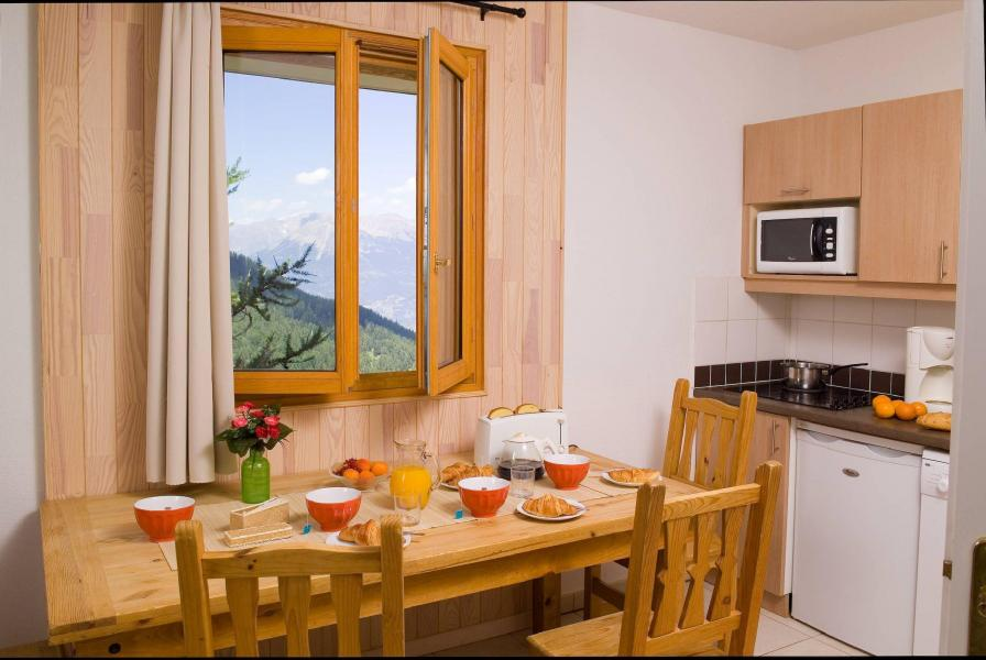 Holiday in mountain resort Résidence le Balcon des Airelles - Les Orres - Dining area