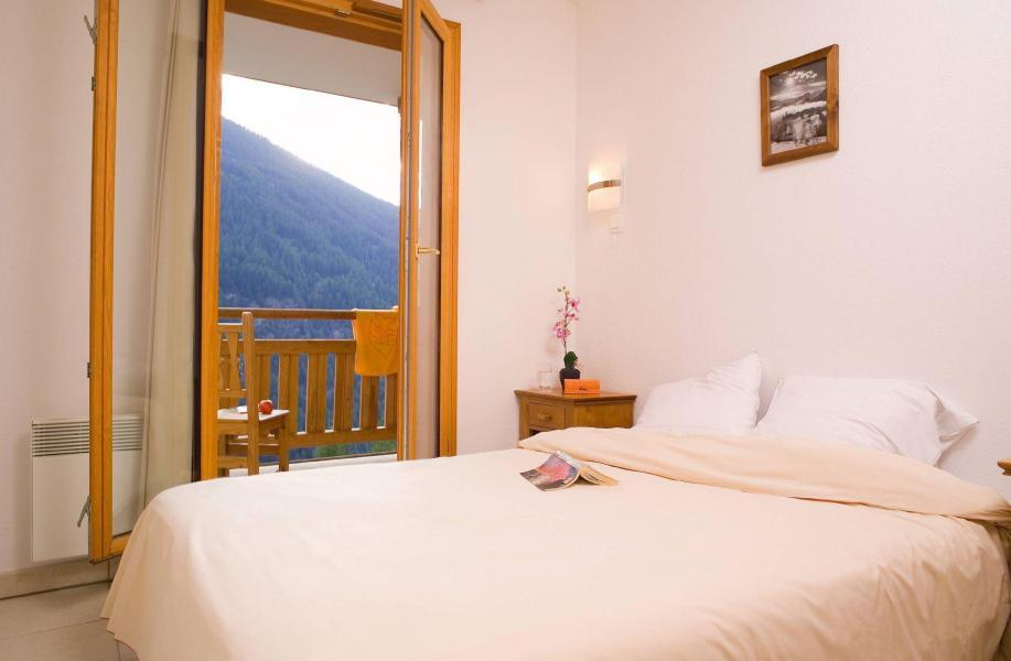 Urlaub in den Bergen Résidence le Balcon des Airelles - Les Orres - Doppelbett