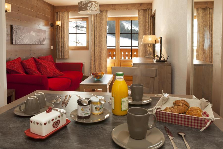 Vacances en montagne Residence Le Grand Lodge - Châtel - Coin repas