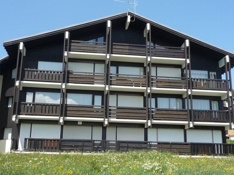 Location au ski Résidence le Village 4 - Les Saisies - Extérieur été