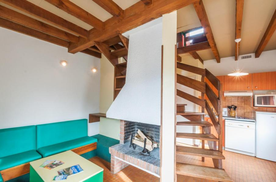 Vakantie in de bergen Résidence le Village la Souleille des Lannes - Guzet - Woonkamer