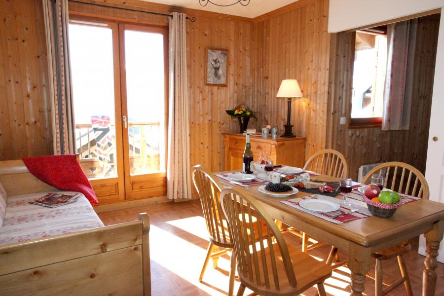 Vacances en montagne Residence Les Chalets Des Cimes - La Toussuire - Coin repas