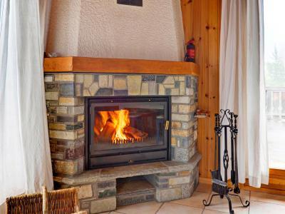Vacances en montagne Chalet Krokus - Thyon - Cheminée