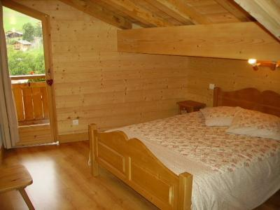 Holiday in mountain resort 7 room duplex chalet 14 people - Chalet le Marjency - Le Grand Bornand - Bedroom under mansard