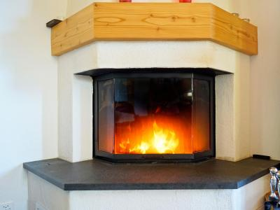 Holiday in mountain resort Chalet Panorama - Thyon - Fireplace