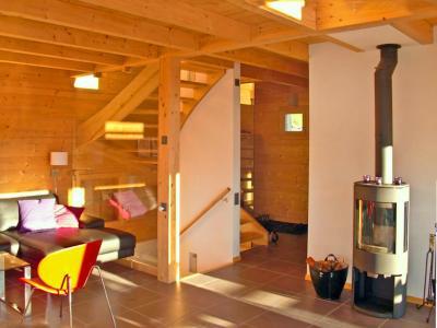 Vacances en montagne Chalet Sur Piste - Thyon - Poêle à bois