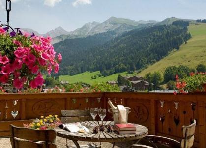 Location au ski Hotel Carlina - La Clusaz - Extérieur été