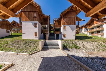 Location au ski Les Chalets Du Hameau Des Aiguilles - Albiez Montrond - Extérieur été