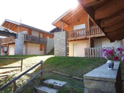 Rent in ski resort Les Chalets Petit Bonheur - La Norma - Summer outside