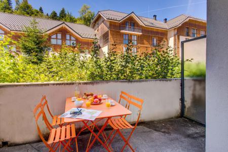 Vacances en montagne Résidence les Balcons d'Aix - La Féclaz - Extérieur été