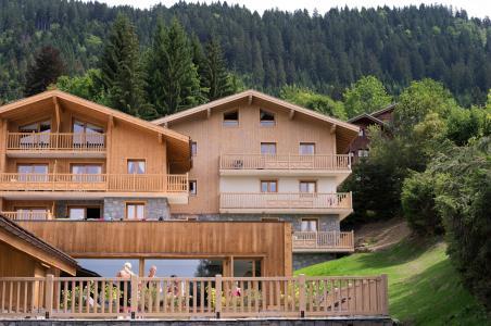 Location au ski Résidence les Chalets de Jouvence - Les Carroz - Extérieur été
