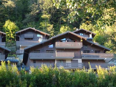 Rent in ski resort Résidence les Chalets du Ponthier - Courchevel - Summer outside