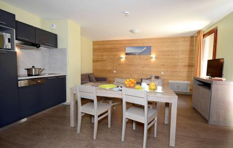 Holiday in mountain resort Résidence Prestige la Cascade - les Epinettes - Vaujany - Dining area
